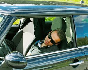 Man sleeping in car